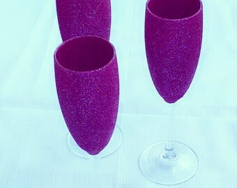 Purple glitter champagne glasses