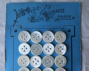 antique pearl buttons on a card,art nouveau period circa 1900