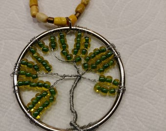 tree of life rear view mirror hanging charm with lime green and yellow seed beads.