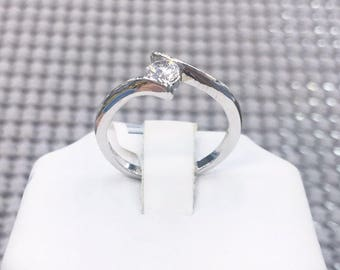 Simplistic Sterling Silver Ring with Center Diamond