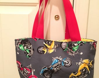 For all the Harley girls. A motorcycle tote/purse with longer straps.