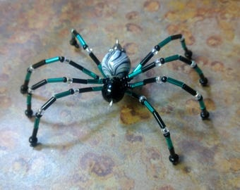 Green/Teal and Black beaded spider.