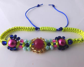 Bright and sparkly interesting macrame bracelet in blue, pink and bright yellow