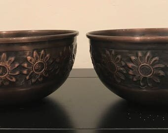Two Floral Hammered Copper Bowls