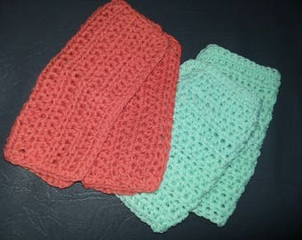 A set of four chochet dish clothes