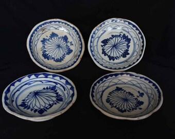 Four porcelain bowls