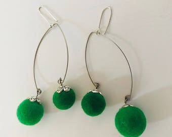 Earrings with green felt balls