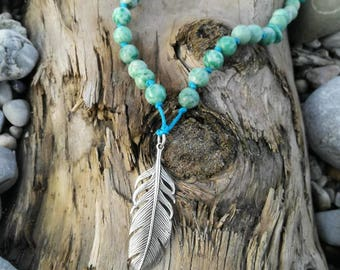 Necklace made of gemstones with feather pendant