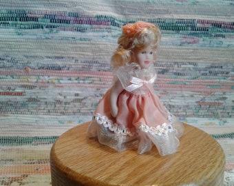 Miniature doll figurine
