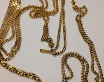 Gold tone Monet 52 inch chain necklace.  Two strands. Vintage.  Chain interspersed with different patterns. Glistening in the light.