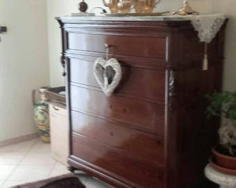 The 800-century restored walnut-wood dresser and key and handmade locks