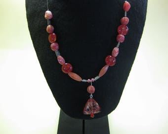 Amber coloured glass bead necklace on a wire