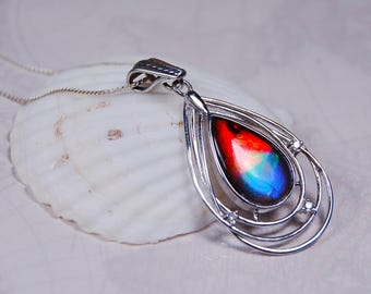 Ammolite pendant.For the lady that likes dramatic impact in Jewelry.Bright Rainbow teardrop.#081117
