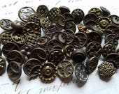 Fifty Five (55) Victorian Charm String Metal Buttons. Have wear. As Found.