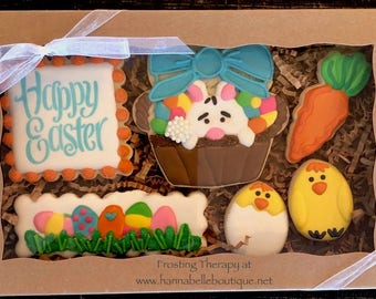 Happy Easter basket themed decorated sugar cookies. Holiday, eggs, rabbit, bunny, carrots, candy