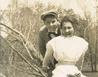 Vintage photo 1920 Young Couple Sit in Tree She Fold Out Brownie Kodak Camera in Lap