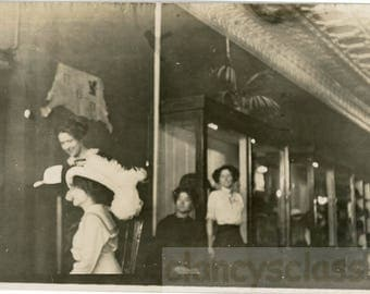 vintage photo 1914 Women Trying a Big Hat Millinery Store RPPC