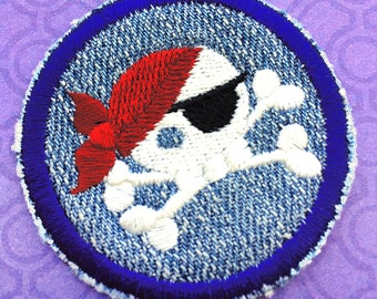 """Round Iron On Patch, Pirate Skull with Cross Bones Embroidered on Blue Denim Background, about 2"""" x 2"""""""