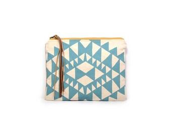 cosmetic pouch • geometric print make up bag • aqua blue triangle print - waxed canvas - geometric print • large clutch - make up bag