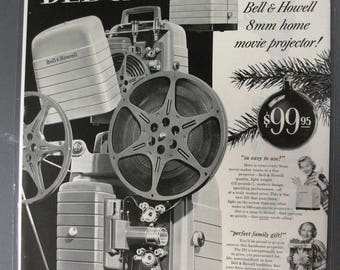 104  Bell & Howell  Ad From Dec 1952 Holiday