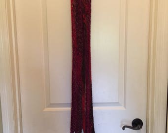 Handknit variegated feather and fan design scarf