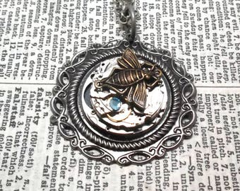 Bejeweled and Charmed Clockwork Mechanism Pendant with Brass Bee Charm and Blue Crystal