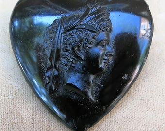 An Antique Black Glass Cameo Pin