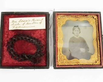 Antique Victorian Era Daguerreotype Photo of a Woman with Lock of Braided Hair in Case. Circa 1840's - 1850's.