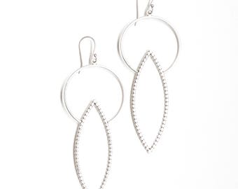 """Sculptural silver earrings, fabulous pairing of circle and leaf shapes each handmade of flattened sterling silver wire - """"Calypso Earrings"""""""
