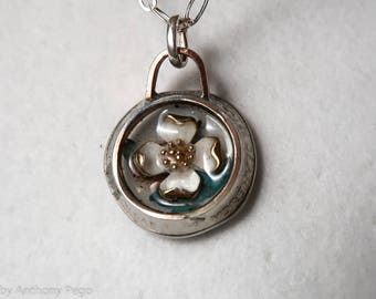 White enamel and metal flower set in US quarter, backed with turquoise shards and Oklahoma red dirt