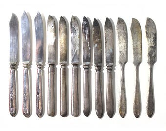 Set of 12 Silver Plate Scrap Butter Knives
