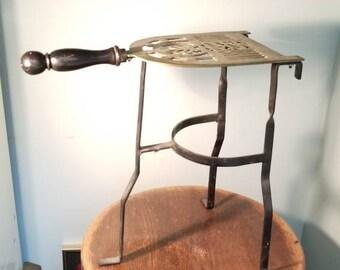 Vintage sad iron holder or table