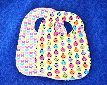 Baby Girl Bibs, Set of 2, Butterflies and Lady Bugs backed with Terry Cloth with Snap Closures