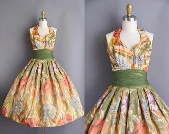 Gorgeous vintage 1950s floral water color halter vintage dress. 1950s vintage dress