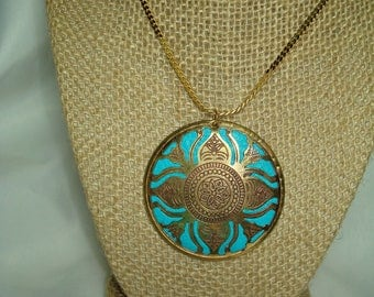 1992 Gold Tone with Turquoise Colored Aztec Like Large Pendant on Gold Tone Serpentine Chain.