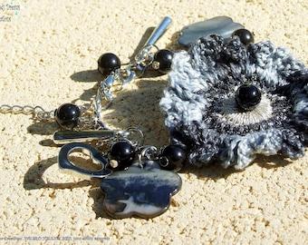 Silver romance bracelet, black and silver crocheted flower