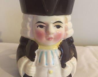A cute, antique Toby jug Judge character.