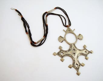 Ethnic style cross necklace with stylized cross pendant