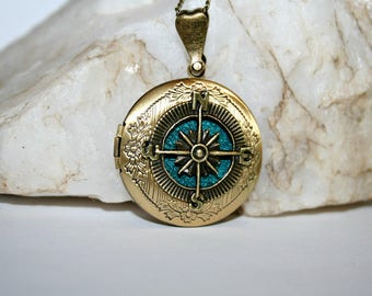 With a turquoise background (v) compass photo pendant
