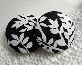 Black fabric button with white leaves, 40 mm in diameter