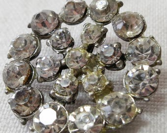 2 Vintage rhinestone buttons, open work star or flower shape, 1 shown, both  similar 2nd has 7 smaller stone central wheel. CLAM15.3-7.5-11.