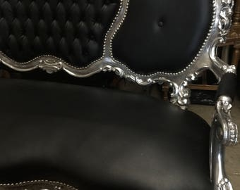 Black and silver sofa. Interior design. Fig House Vintage. Rock and Roll Gothic style