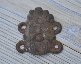 "Antique metal plate,decor ""Male head"" with original patina."