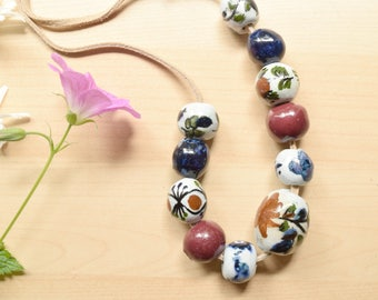 Handmade Ceramic Beads, Hand Painted, Ethnic Jewelry on Leather, Blue Red and Floral