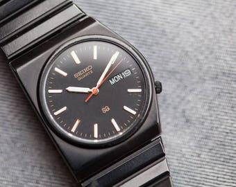 Vintage Seiko quartz watch asymmetrical case black pvd band