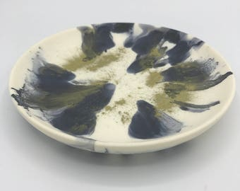 Black, white and metallic gold resin plate