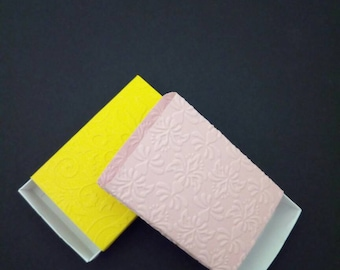 Embossed match boxes