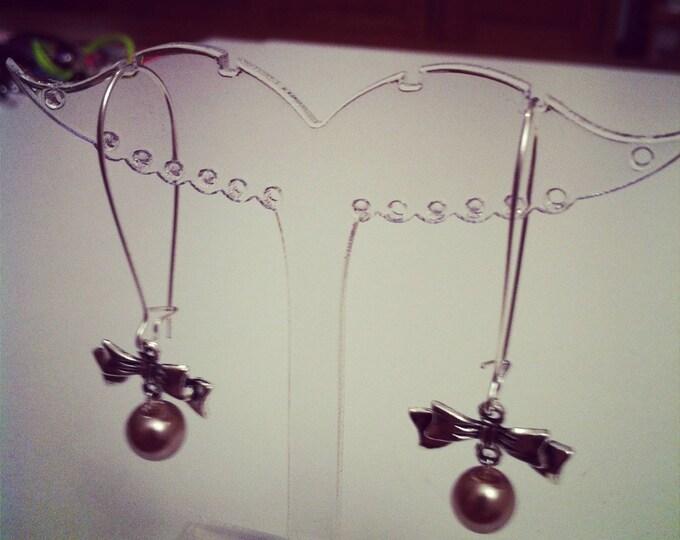 Earrings bows large silvery beige clasps