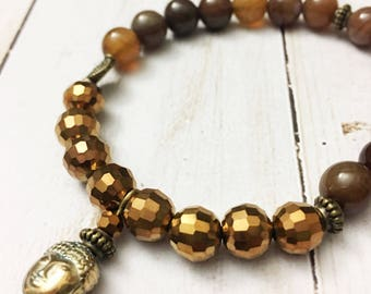 Buddha bracelet with gorgeous striped brown carmel agate beads and faceted bronze crystal beads by Jules Jewelry Box
