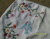 Hand embroidered dresser scarf/ white and trimmed in blue/birds and flowers